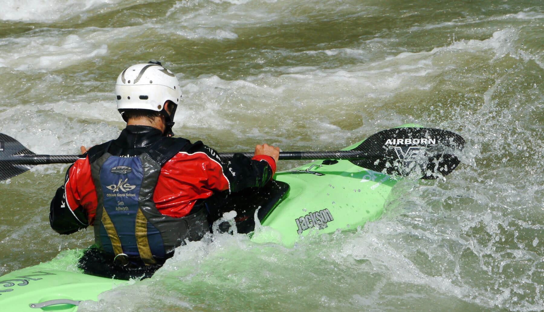 Paddling in a green kayak