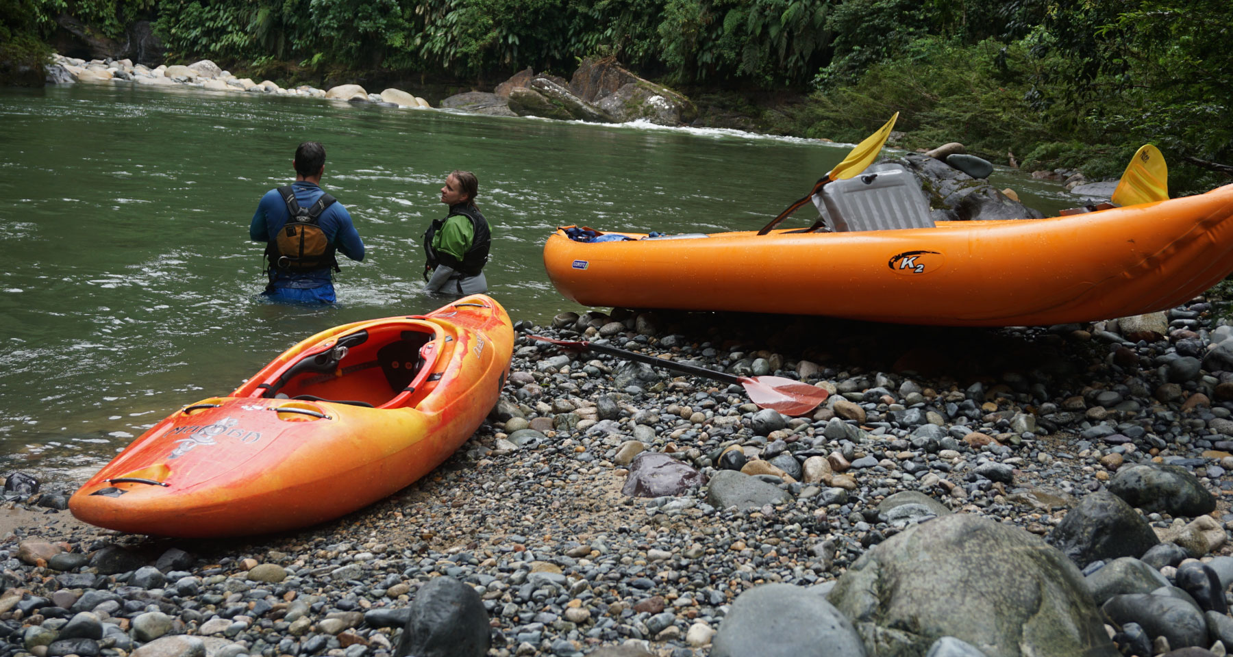 A duckie and a kayak in the shores of a river