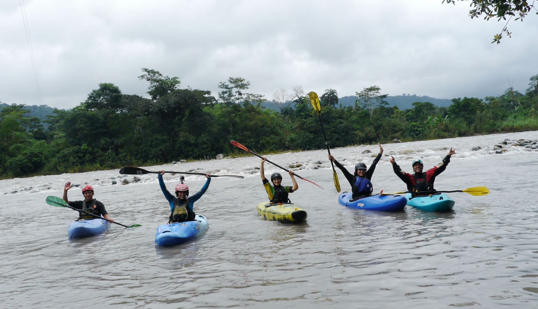 Happy students learning kayak