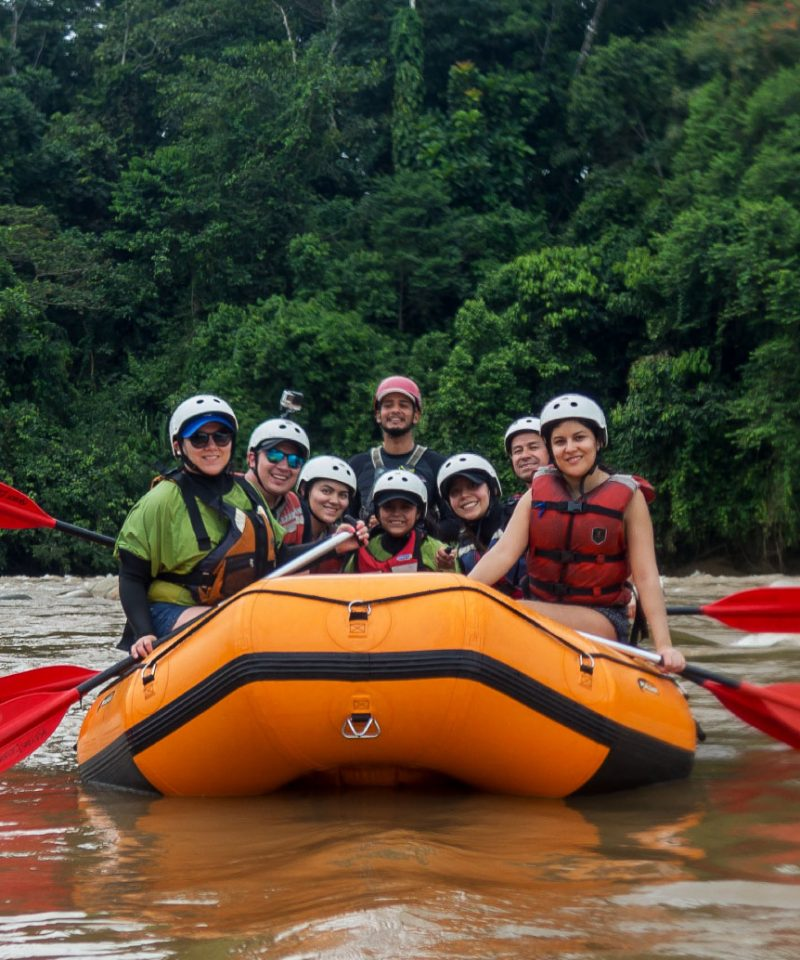 Friends and family in a rafting boat in Anzu river in Southamerica, Ecuador