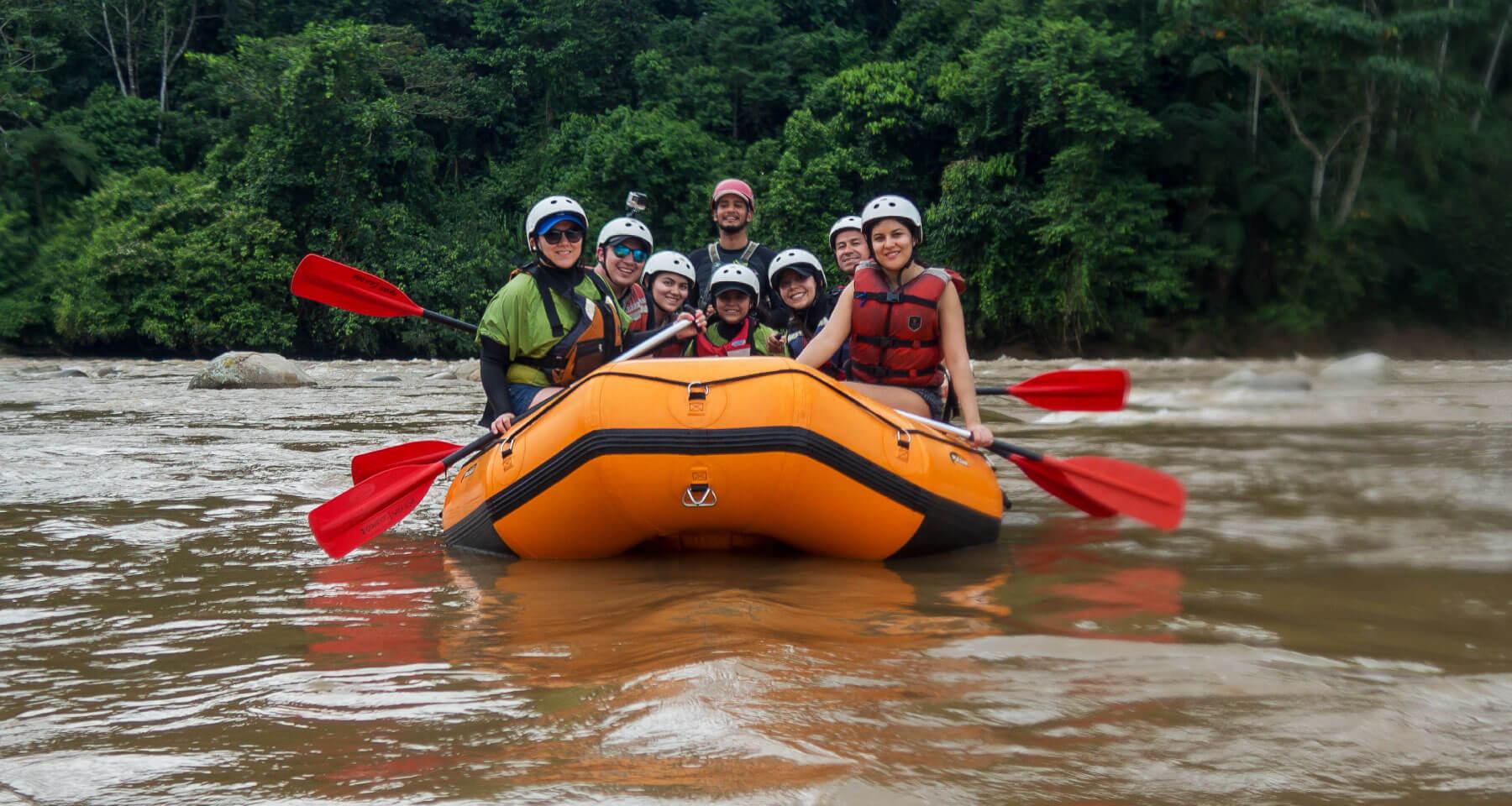 Friends and family in a rafting boat in Anzu river in Southamerica, Ecuador