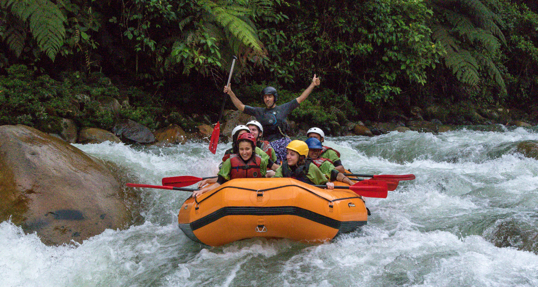 Descending rivers in raft boat in Ecuador
