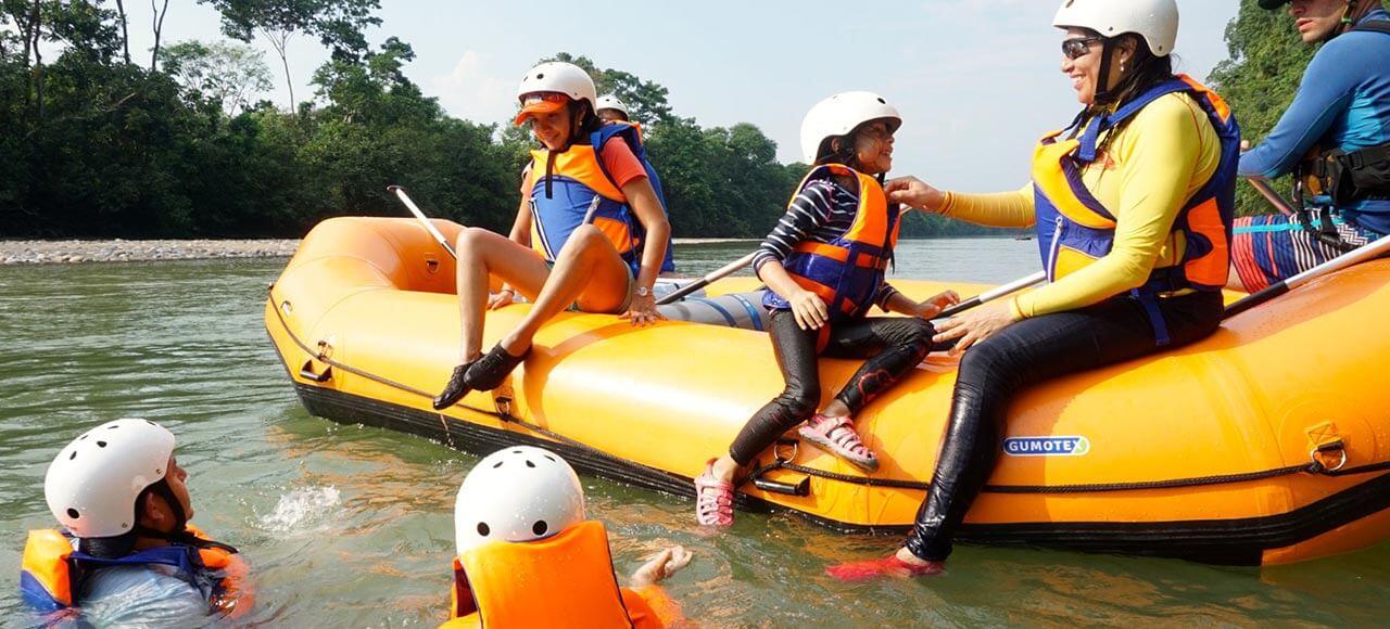 Family in a raft in Anzu River in Ecuador