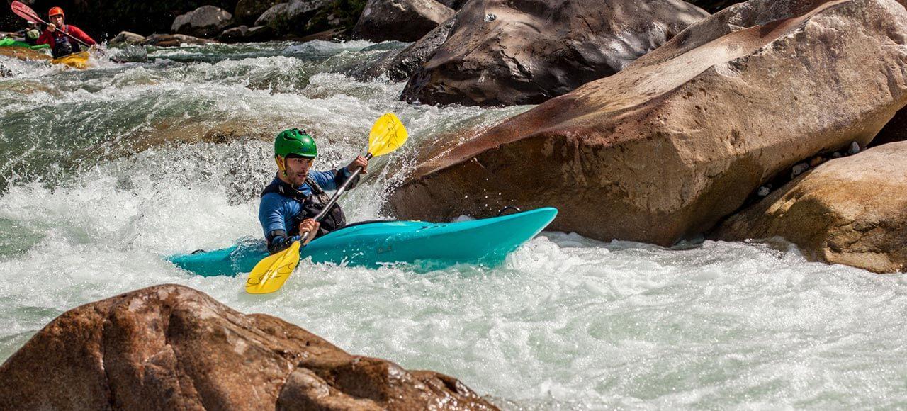 Santiago Canala paddling in the river. Napo, Ecuador.