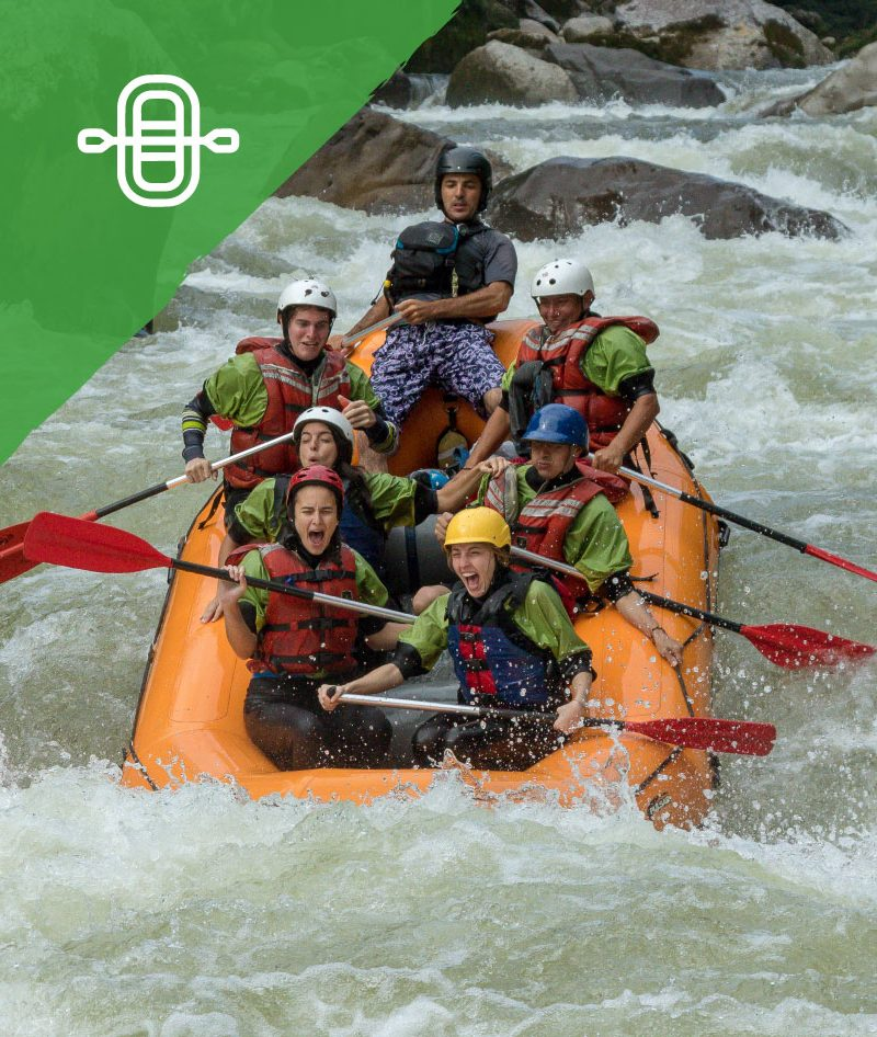 Group of people excited about the river while rafting