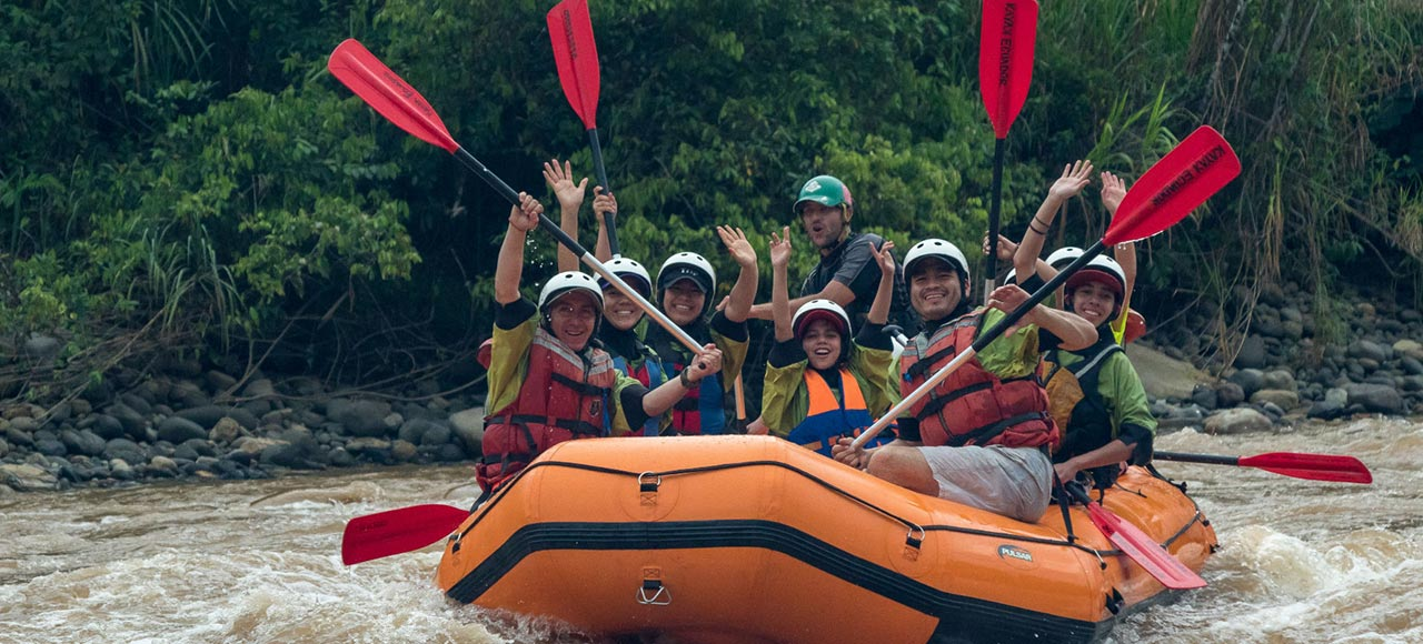 Rafting boat with happy people in the middle of the jungle