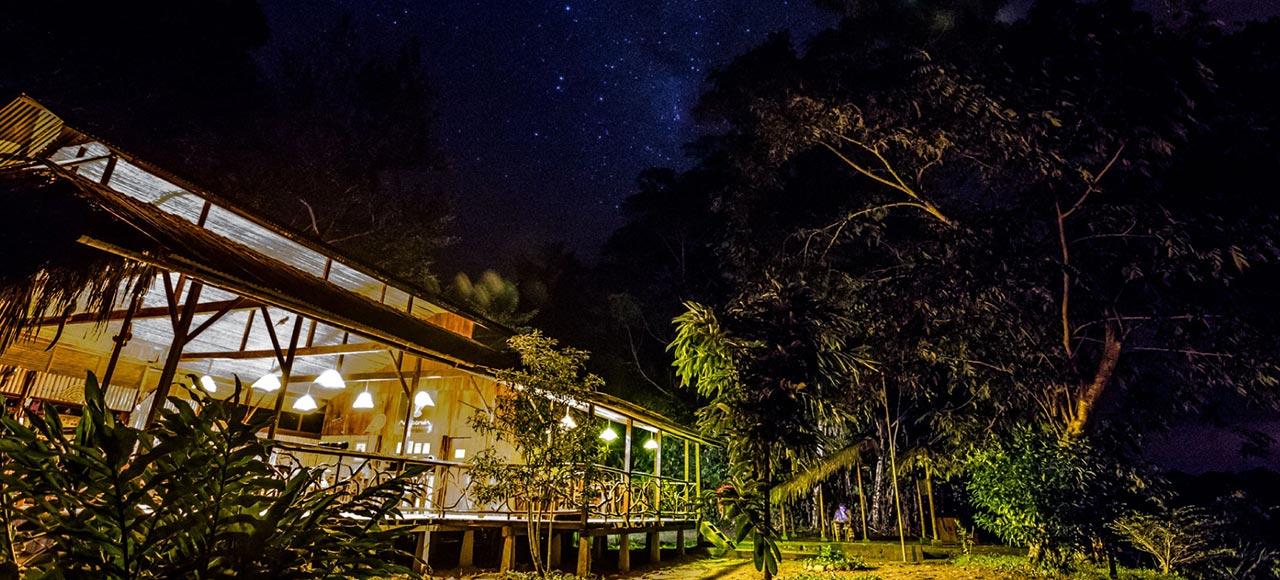 Night photo of Anaconda Lodge, in amazonian jungle in Ecuador