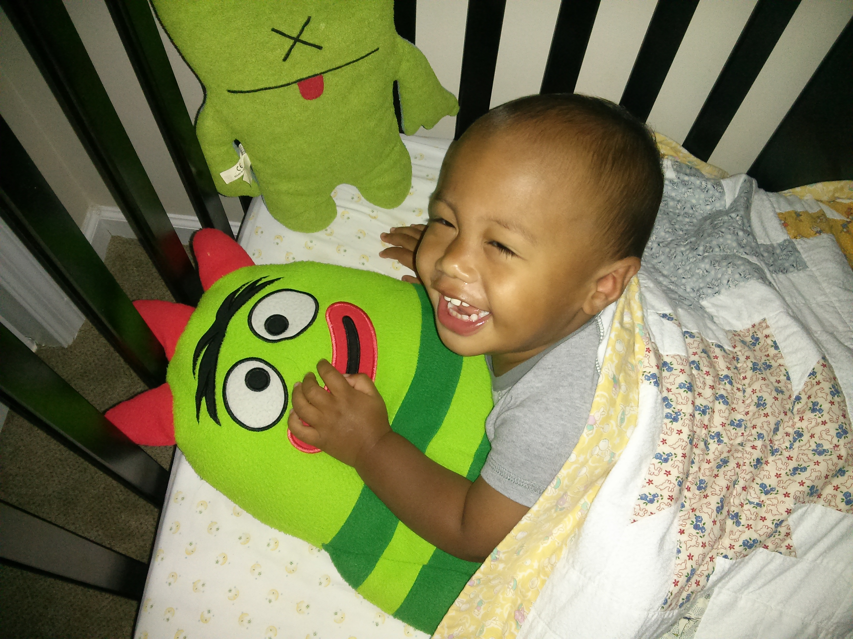 boy in crib with toy