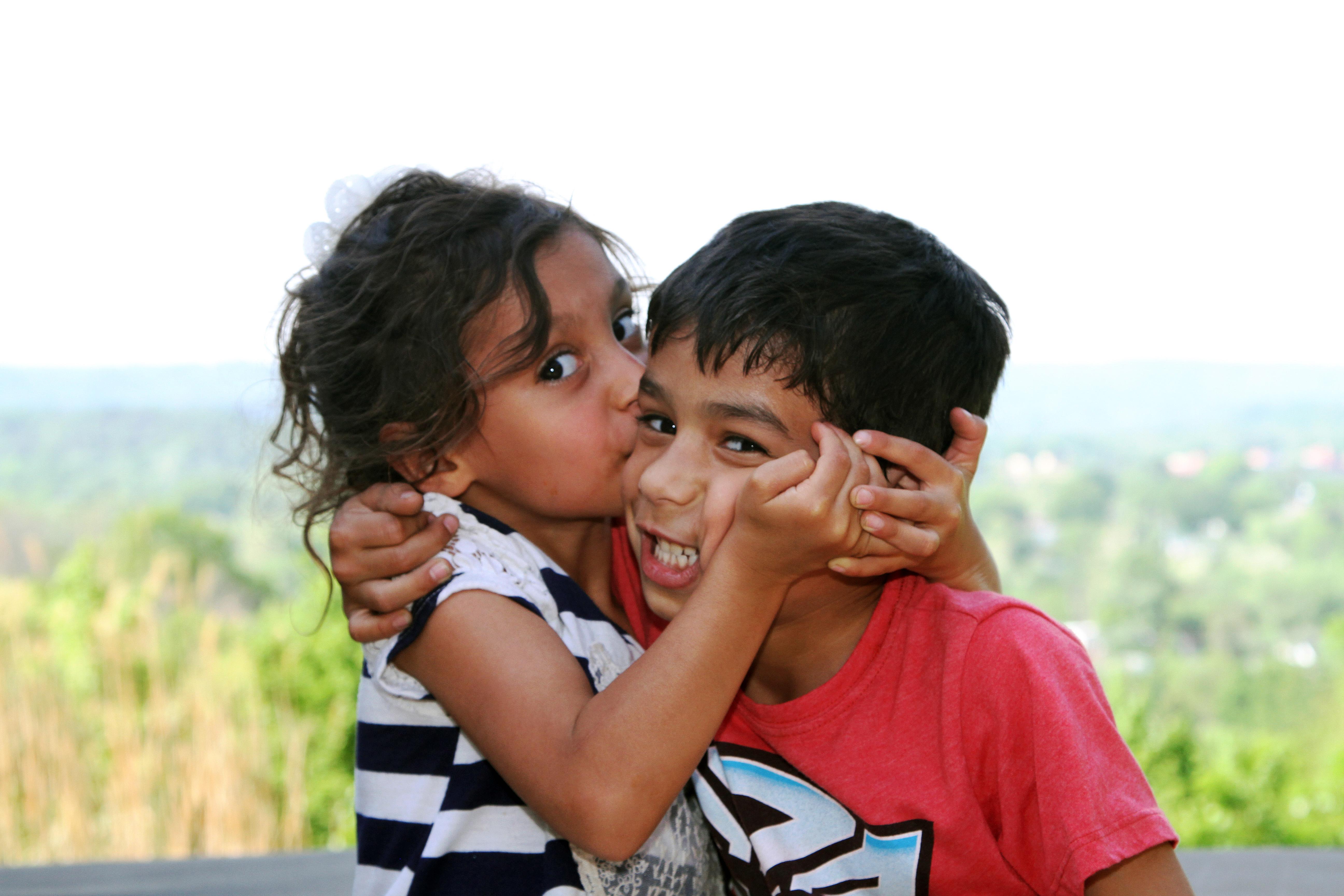 siblings_happy_kissing
