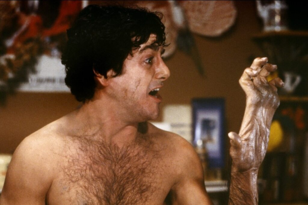 An American Werewolf in London — David Naughton freaking out about his transforming hand during the full moon.
