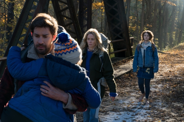 Family from A Quiet Place walking together outdoors