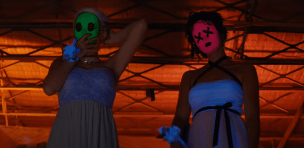 Teen girls in pretty dresses and weird masks in Tragedy Girls