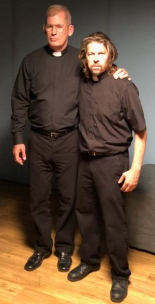 Peter Murnik (Father Dan) and Kyle Hester (Father Joshua) behind-the-scenes of Preacher Six, dressed as preachers.