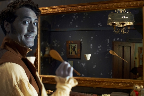 vampire goofing off in front of a mirror in What We Do in the Shadows