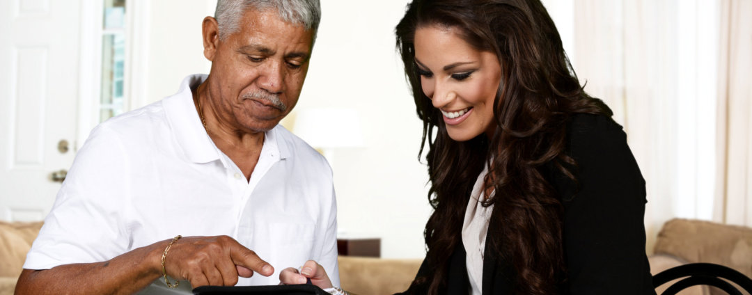 caregiver and a old man smiling