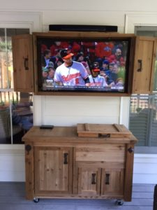 outdoor-tv-media-cabinet-and-rustic-cooler-table