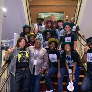 The Dream Choir poses backstage with Amy Ray of the Indigo Girls at the Georgia On My Mind concert at the Ryman Auditorium, July 2019