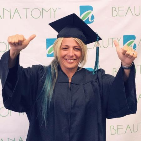 Beauty Anatomy Graduate giving thumbs up to camera