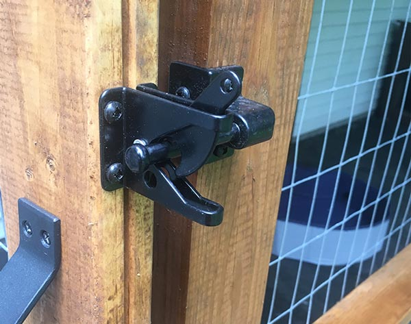 husky nose proof latch, installed outside the kennel- no more carabiner needed.