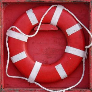 Red life saver in a wooden box