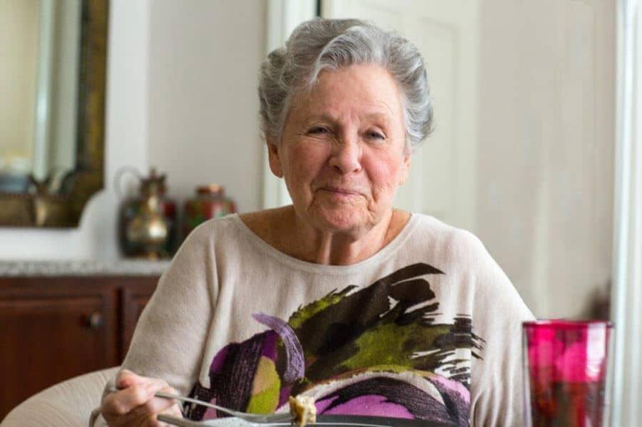 Senior woman having dinner