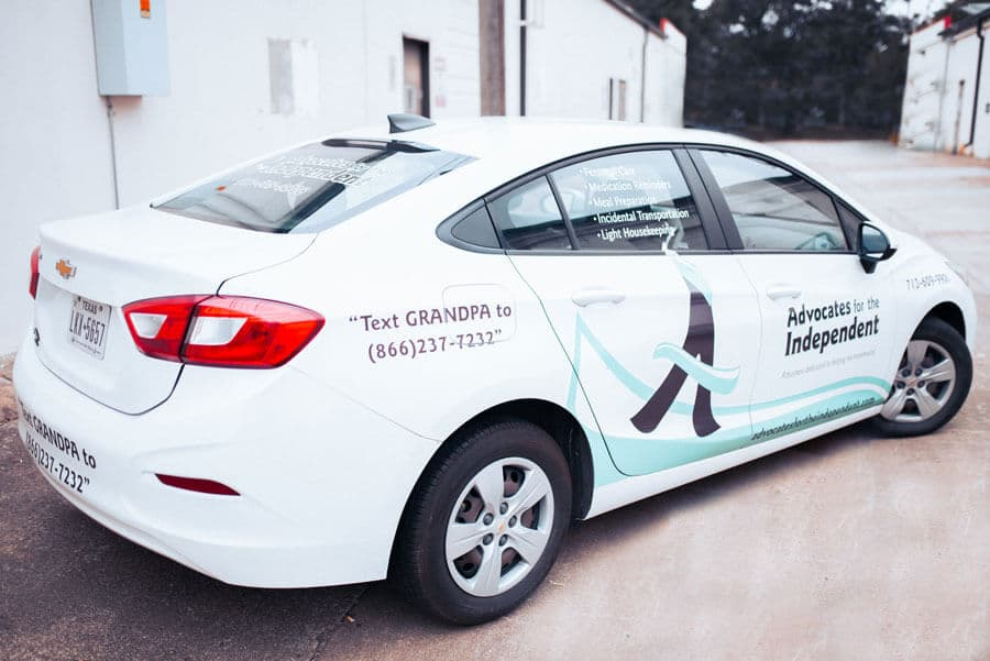 Car wrapped with Advocates for the Independent company logo