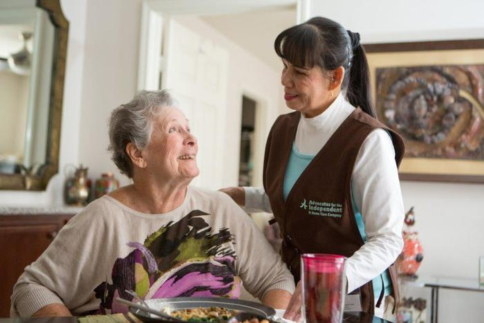 Caregiver with client at mealtime