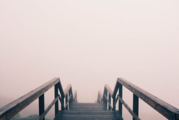 Board walk rising out of fog