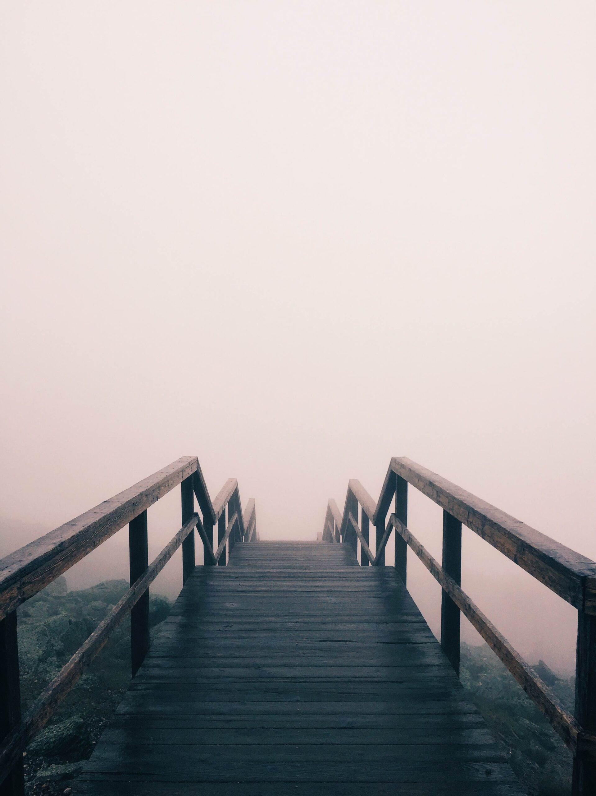 Board walk rising out of fog
