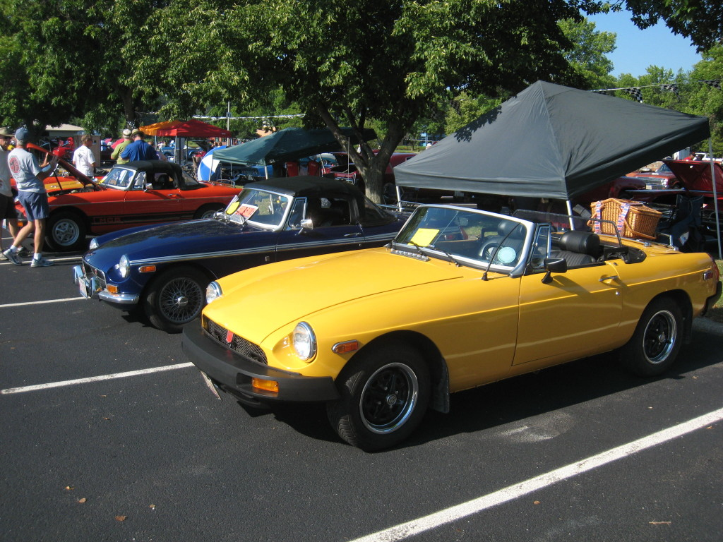 1976 MGB (Sunshine Yellow) we have owned the car since 1993. The paint job was done that year, and has held up very well. It has been a fun ride, now that we are down in central Florida, it is driven every day. Winter's down here are just a good excuse to go for a ride, and explore, there are car shows here literally every weekend, within 100 miles of us, all year round!