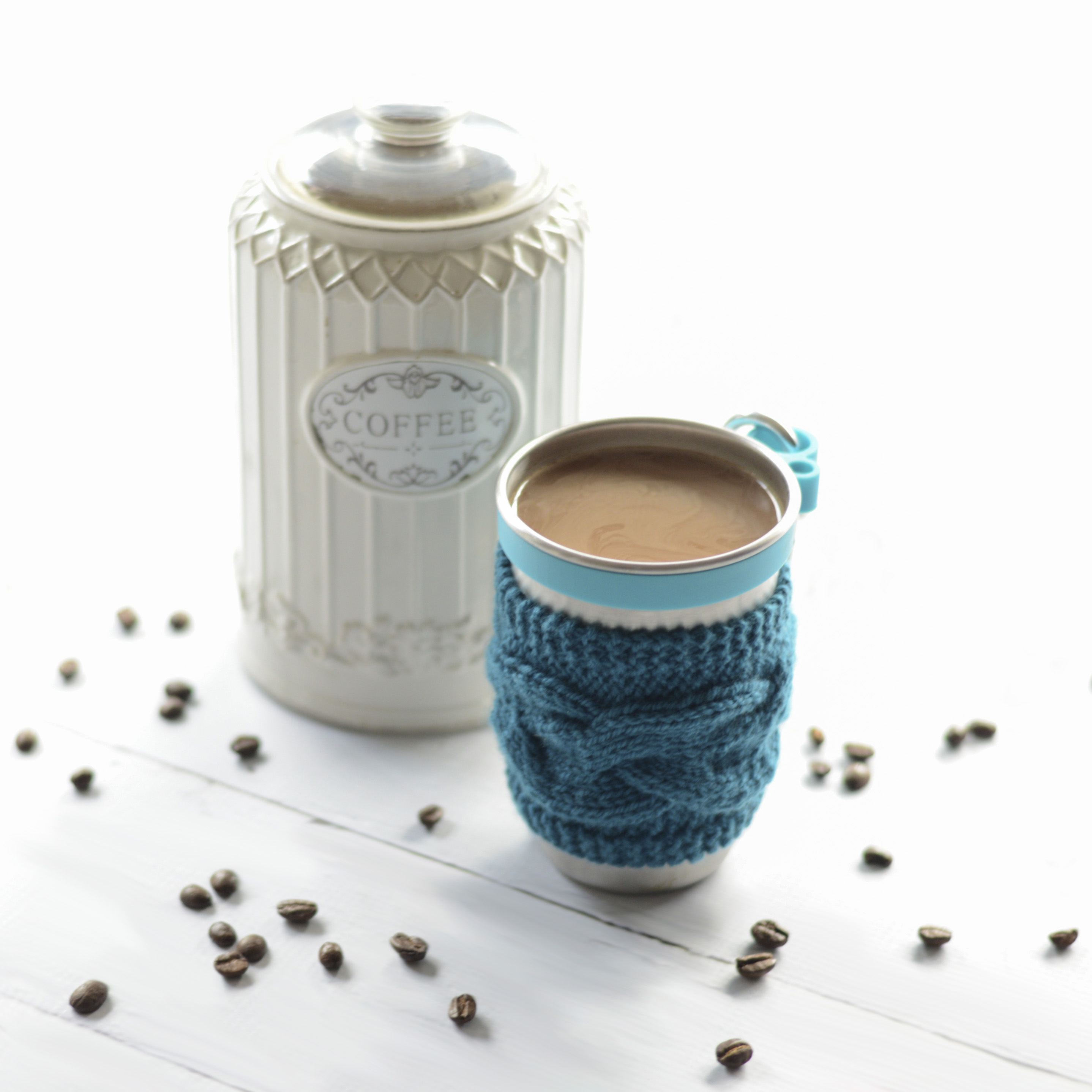 steel cup with crocheted coffee cups cozy
