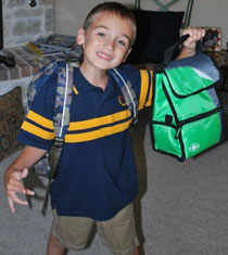 Boy Holding Up Lunchbox
