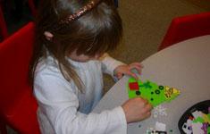 Girl making paper tree