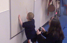 Boy at dry erase board