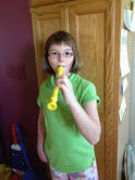 girl with cerebral palsy playing recorder with one hand