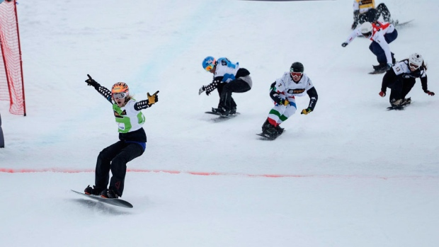 Dominique Maltais, left, cheers after winning the race in Arosa, Switzerland on Saturday. (Samuel Truempy/Associated Press)