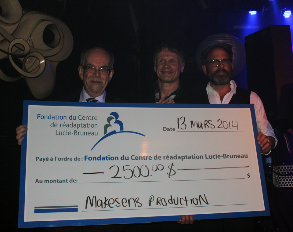 Pierre-Paul Millette, Directeur Général at Centre de Réadaptation Lucie-Bruneau, Claude Le François and Frédéric Loiselle from the Centre as well, accepting their check.  Snoezeland Benefit. Photo Lili Hudecova.