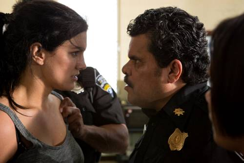 "Gina Carano (left) and Luis Guzman (right) in ""In the Blood"""