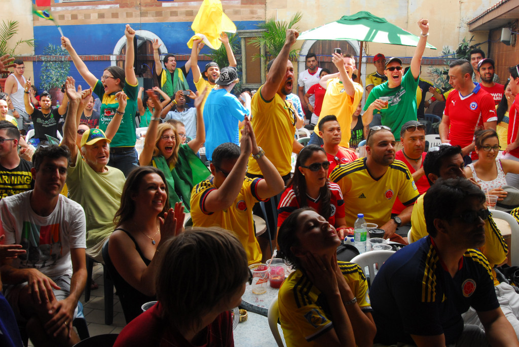 Brazilian and Chilean fans watch Brazil play Chile at the 2014 FIFA World Cup. Cafe Frappé. Photo German Silva.