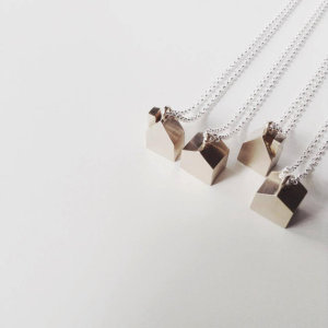 little bronze house necklace by the angry weather