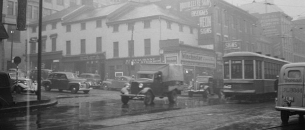 The intersection of Saint Lawrence Boulevard and Craig Street on a rainy day in October 1941. Photographed by Conrad Poirier. Photo courtesy Pistard/BAnQ (P48,S1,P6888)