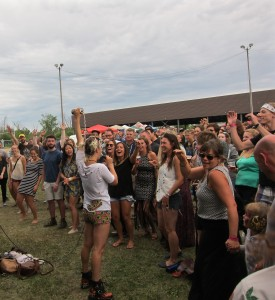 Lowell with the dancing crowd at Wolfe Island Music Festival 2015. Photo Stephanie Weiner.