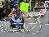 "Hoop dancer ""cradling baby"". Missing and Murdered Aboriginal Women March and Vigil. Photo Rachel Levine"