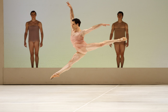 Photo by Bruce Zinger, courtesy of The National Ballet of Canada. Piotr Stanczyk with Artists of the Ballet in Chroma.