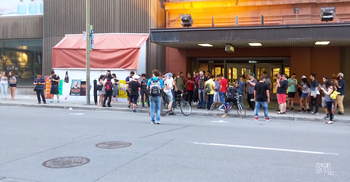 Pokémon Go Meetup Across the Street from McGill Metro. Photo Sarah Luger.