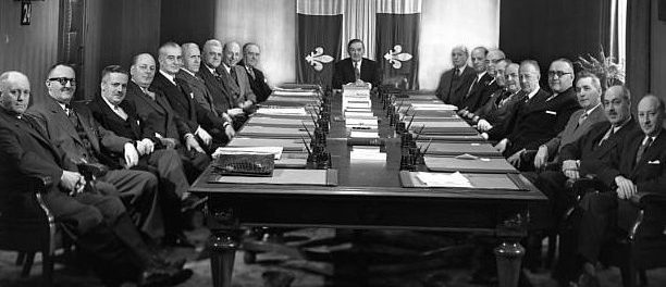 The 1954 Maurice Duplessis cabinet. Note the Québec flag in the background.