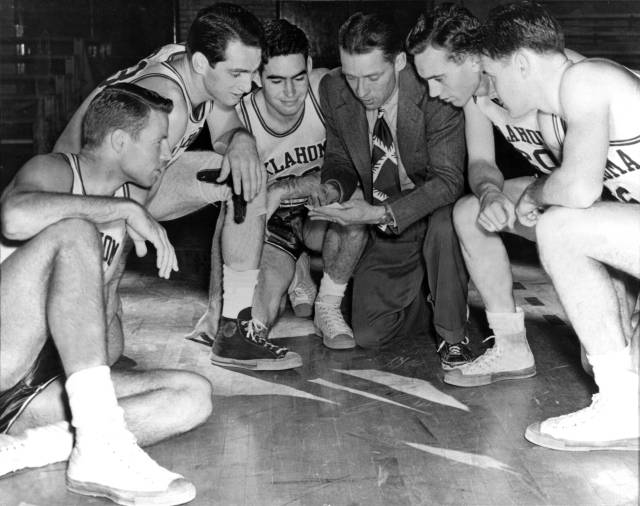 Hall-of-Fame head coach Bruce Drake with the starters on his 1946-47 squad that reached the NCAA title game (players from left are Dick Reich, Gerald Tucker, Jack Landon, Allie Paine and Paul Courty).