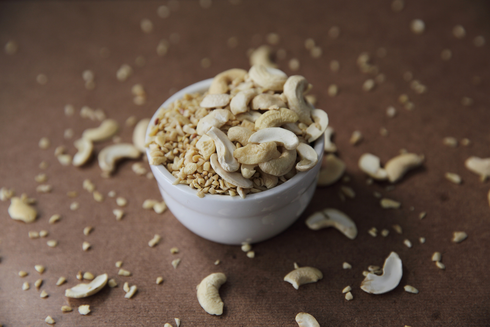 crushed peanuts on wood background in mystic light