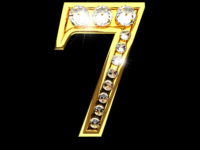 7 isolated golden letters with diamonds on black