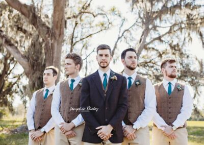 Love this portrait of this groom and groomsmen in winter. Image by Umphie Photos.